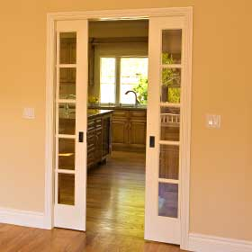 pocket door in dining room with electrical switches