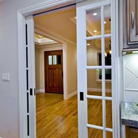 pocket door in kitchen with electrical outlets